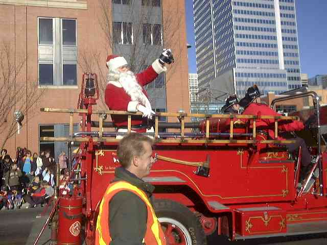 Santa Claus waving at a Christmas Parade